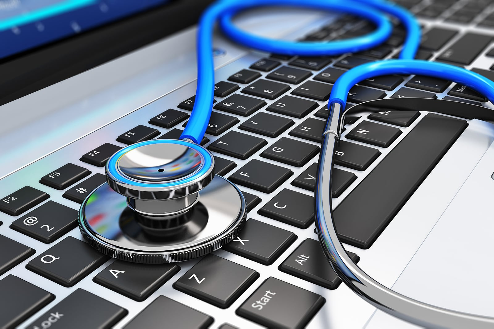 Photo concept of smart looking medical stethoscope placed on top of computer keyboard keys symbolising project diagnosis