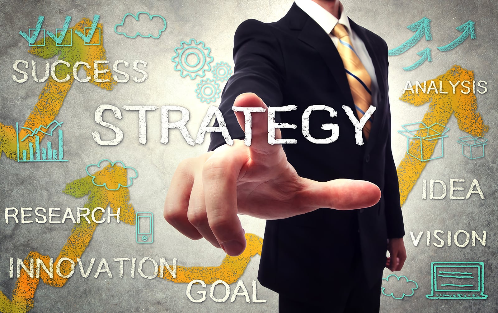 Photo concept image of business man pointing at the word Strategy in a word cloud of words related to strategy and strategic thinking