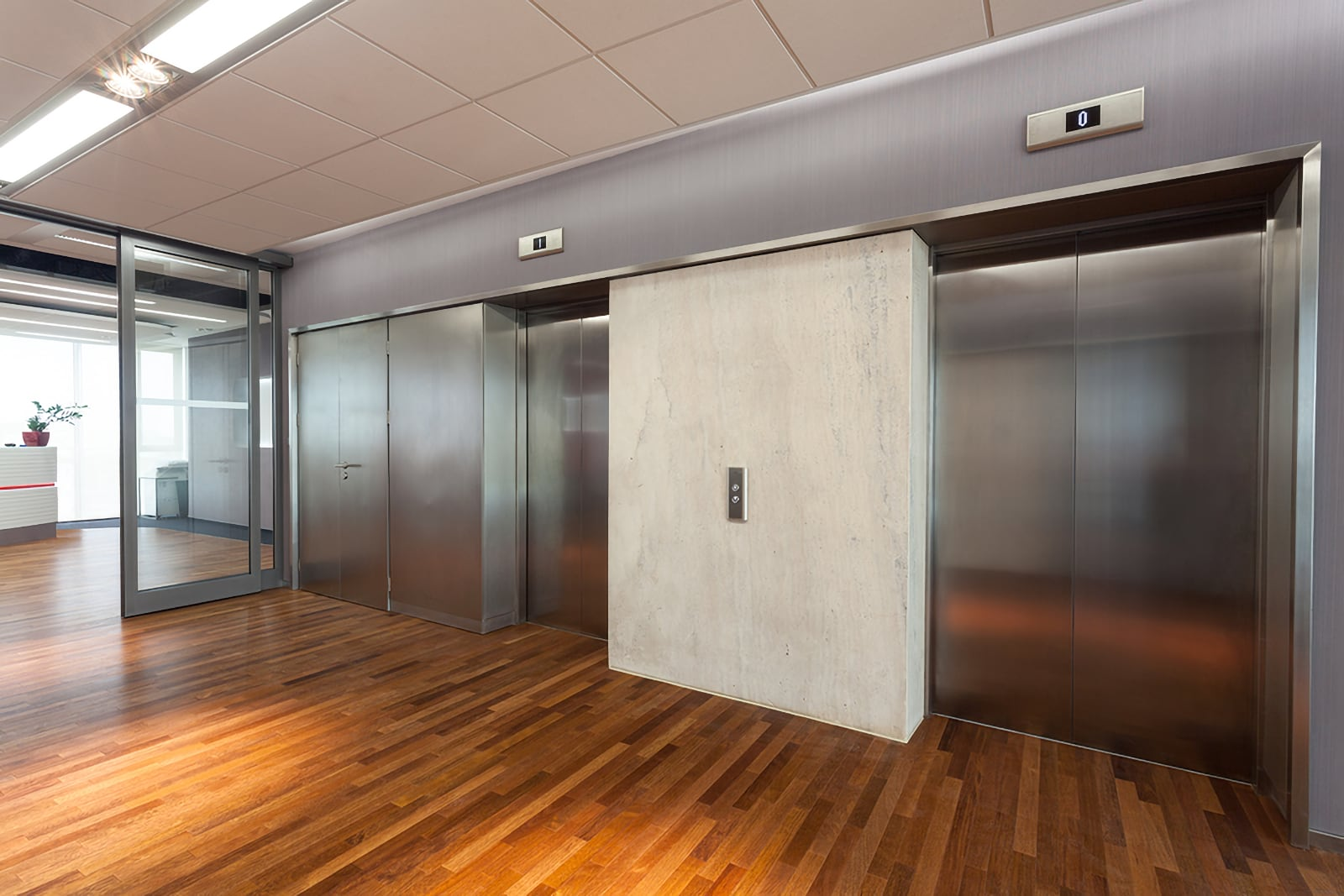 Photo of hall in the office facing the lift doors